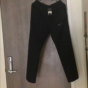 NWT men's Nike Dri-fit lightweight pant. Size S